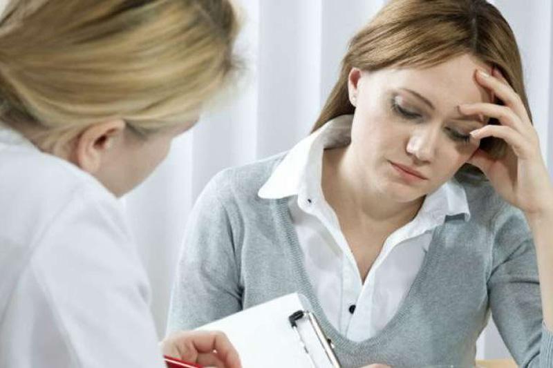 Коричневые выделения в середине менструального цикла